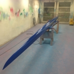 Rowing shell paint job