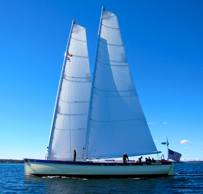 The first sail of FARFARER and her custom carbon spars fabricated at CEI